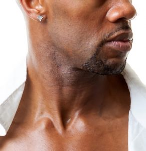 Close up of neck and ear of black man with stud earring