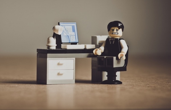 frustrated lego man at desk